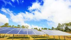 Solar panel Supplying Electricity with White Clouds and Blue Sky - stock footage