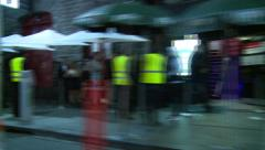 Clubs & Club patrons in city streets at night Stock Footage