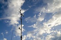 Anemometer and wind vane on blue sky Stock Photos