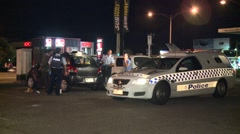 Police talking to motorists at night Stock Footage