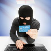 Hacker holding credit card and Canadian province flag on background - Alberta - stock photo