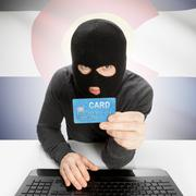 Hacker holding credit card with US state flag on background - Colorado - stock photo