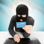 Stock Photo of Hacker holding credit card with US state flag on background - Oklahoma