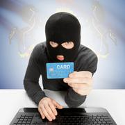 Stock Photo of Hacker holding credit card with US state flag on background - Pennsylvania