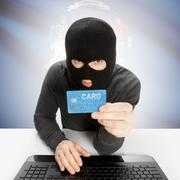 Stock Photo of Hacker holding credit card with US state flag on background - Wisconsin