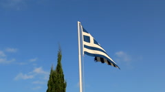 Greek flag and cypress tree Stock Footage