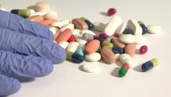Searching medicines in the white background Stock Footage