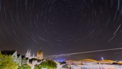 Stock Video Footage of Stars are forming trails over a city