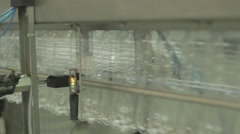 Mineral water production in the factory. Plastic bottles  on a conveyor belt. Arkistovideo