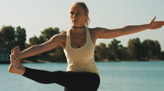 Young woman is doing professional yoga workout on the beach. Stock Footage