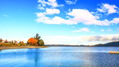 Blue sky and cloud scape at Te Anau lake at South Island of New Zealand Stock Footage