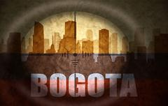 sniper scope aimed at the abstract silhouette of the city with text Bogota at - stock illustration