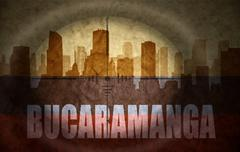sniper scope aimed at the abstract silhouette of the city with text Bucaraman - stock illustration