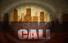 Sniper scope aimed at the abstract silhouette of the city with text Cali at t Stock Illustration