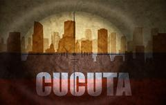 Stock Illustration of sniper scope aimed at the abstract silhouette of the city with text Cucuta at