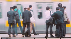 People waiting to board a train at the subway station in Tokyo - stock footage