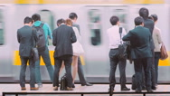 Stock Video Footage of People waiting to board a train at the subway station in Tokyo