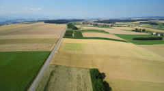Aerial shot over a road in the country side Stock Footage