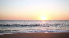 Beautiful sunset reflecting over the ocean - stock footage