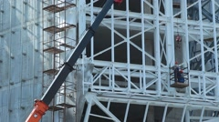 Builders in the cradle, build a building Stock Footage