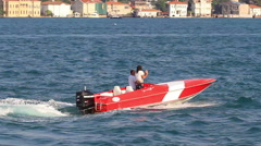 Happy young couple riding speedboat on Bosporus waters. Tracking Video Stock Footage