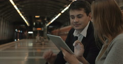 Couple with Tablet PC Waiting for Tube Train Arkistovideo