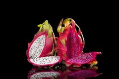 Red and white dragon fruits. Stock Photos