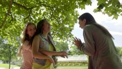 2 Girls Laugh Hysterically, A Friend Comes Over And Hugs One Girl (Slow Motion) Stock Footage