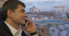 Businessman Talking on the Phone on the Way Stock Footage