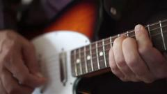 Bar chord, guitar neck, frets - Man plays electric guitar Stock Footage
