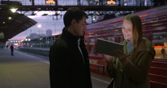 People Using Tablet PC at Railroad Station Stock Footage