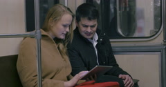 Couple with Tablet PC in Public Transport Arkistovideo