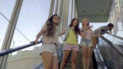 Group Of Teen Girls Ride The Escalator At An Outdoor Mall (Slow Motion) Stock Footage