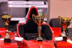 Trophies for winner and red racing car Kuvituskuvat