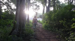 Woman travel in jungle with backpack Stock Footage