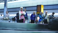 Stock Video Footage of Slow motion passengers at airport waiting for baggage
