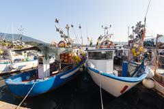 Fishing boats anchored at the port - stock photo