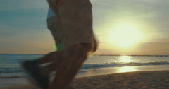 Father and Son are Running by the Sea Stock Footage