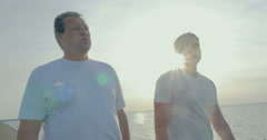 Father and Son Walking after Morning Exercises Stock Footage