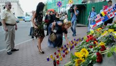 MH17 Flowers and toys memorable memorial near Embassy of the Netherlands (Kiev). - stock footage