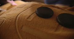Hot Stones on the Body Covered with Towel Stock Footage