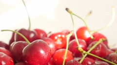 Organic cherries on  white surface slow tilting 4K 3840X2160 UltraHD footage Stock Footage