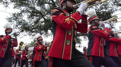 Stock Video Footage of Mardi Gras Day Parade - Red marching band