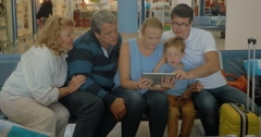 Big Family with Tablet in Waiting Room Stock Footage