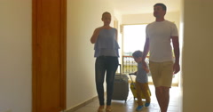 Family Rolling Trolley Bags along the Hotel Passage Stock Footage