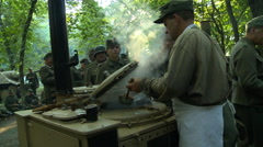 WWII German Field Kitchen serving food to soldiers 3 Stock Footage