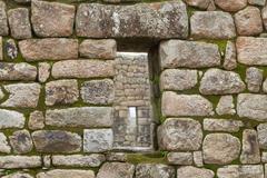 Inca window in a stone wall Stock Photos