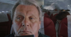 Man in Plane Falling Asleep - stock footage