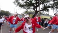 Stock Video Footage of Mardi Gras Day Parade - Male dancers