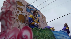 Stock Video Footage of Mardi Gras Day Parade - Pharaoh throwing beads
